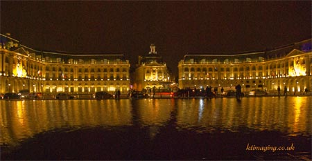 Bordeauz Palace reflects golden light into the water front